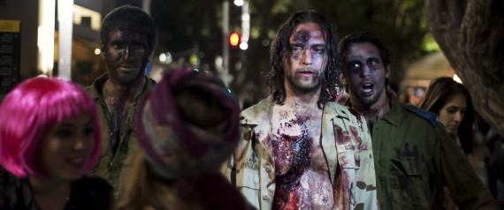 Israelis dressed as a zombies takes part in the customary