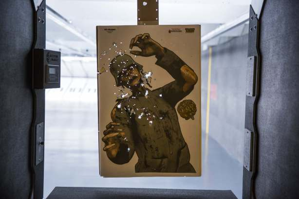A gun target featuring an image of a zombie full of bullet holes is displayed at the Sky Range shooting club at the Solaire Resort and Casino operated by Bloomberry Resorts Corp. in Manila, the Philippines on Wednesday, May 4, 2016. Ahead of the presidential elections on May 9, Bangko Sentral ng Pilipinas Governor Amando Tetangco on April 21 said he doesn't expect any major developments that would necessitate a shift in the central bank's policy stance. Photographer: Taylor Weidman/Bloomberg